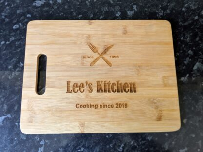 Bamboo chopping board with custom details engraved on