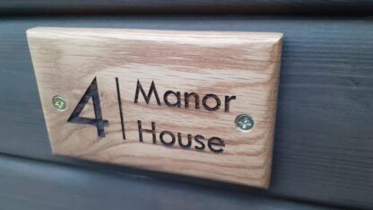 House sign mounted to the wall.