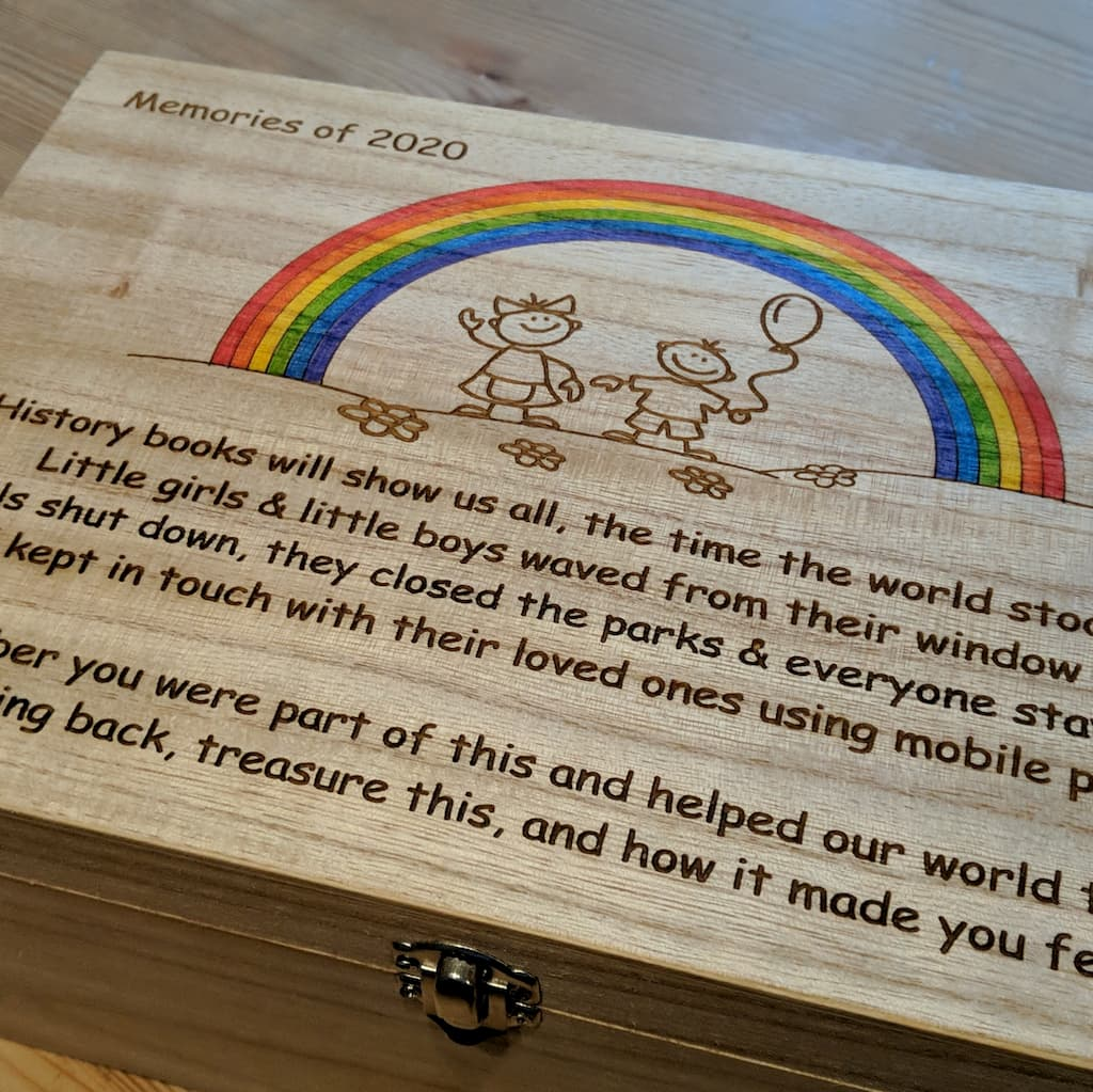 Large box with our rainbow 2020 remembrance plaque engraved on to the top.