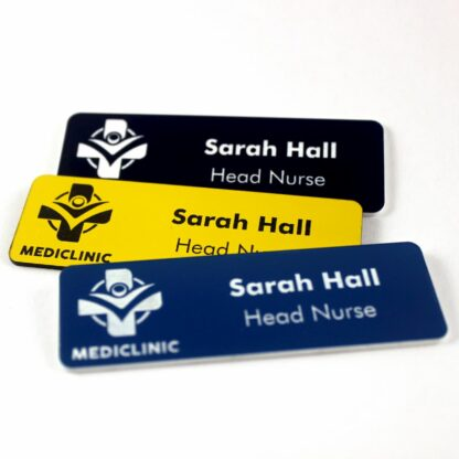 Hospital name badges layered on top of each other.