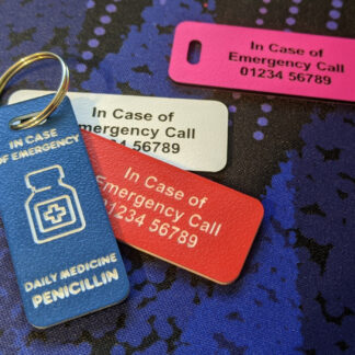 Group of 4 coloured medicine bottle ICE tags