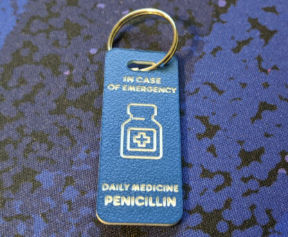 Blue ICE tag with medicine bottle icon.