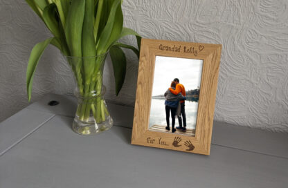 Close up of picture frame standing next to flowers
